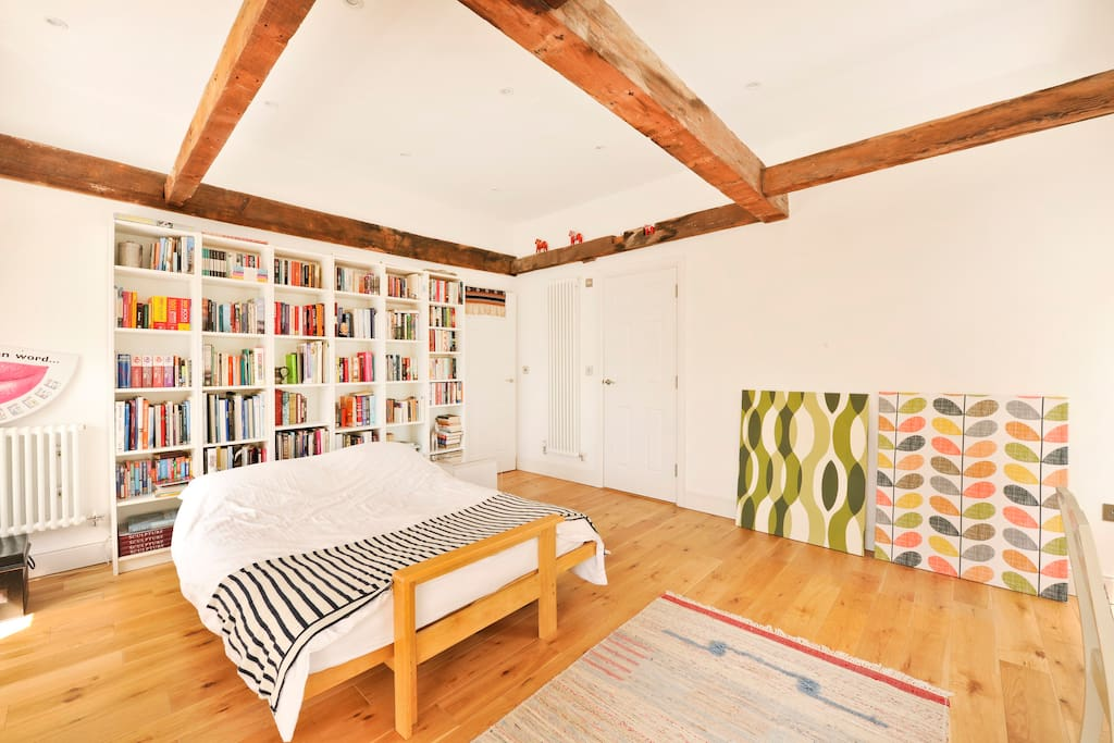 A light and airy room awaits you - check out the historic beams!