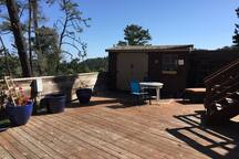 deck area for your use. Chaise, table and chairs.