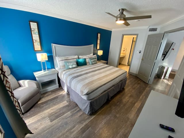 Comfortable Master bedroom with King size bed, Reclining Chair with Massage function.