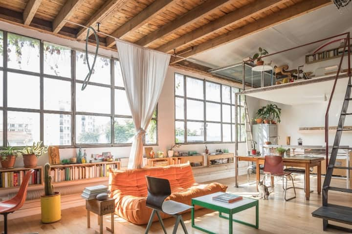 Quiet artist studio loft full of light and books