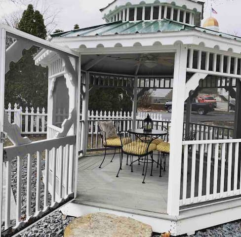 Private backyard gazebo. Gazebo offers lights and a fan.