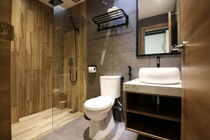 Complete bathroom with shower and toilet.