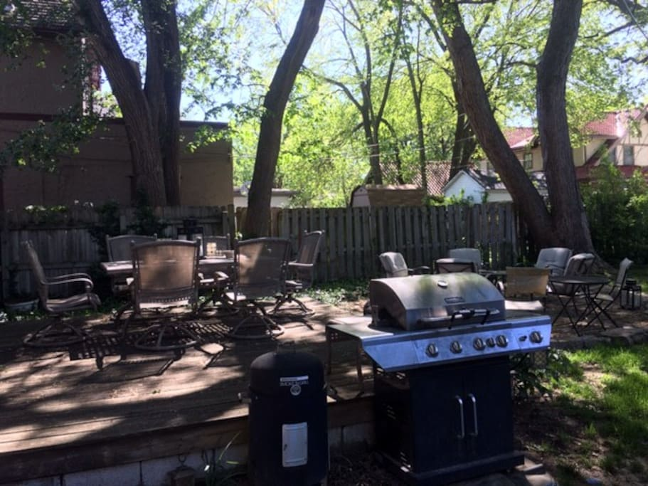 Outdoor oasis with lots of shade. A grill, fire pit and lots of seating.