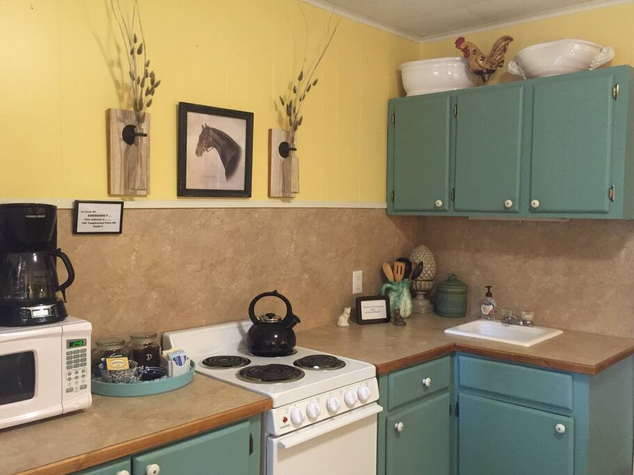 Tally Ho private kitchen, complete with all you need on those cozy nights in! The Tally Ho is a private studio apartment, with a bedroom, bathroom, kitchen and sitting/dining areas.