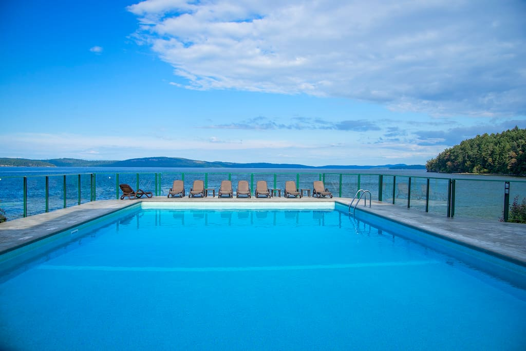 Enjoy lounging by the private pool & hot tub with a panoramic ocean view.