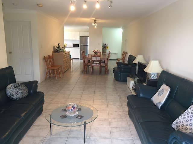 Modern apartment near shopping, amenities & train