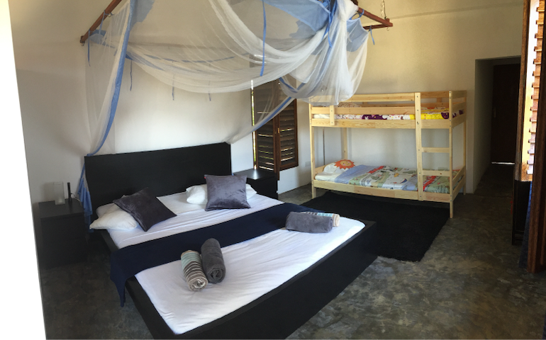 Guest bedroom with kingsize bed and kids bunkbed, private bathroom with hot shower, fan and mosquito nets. Ideal for a couple with kids.