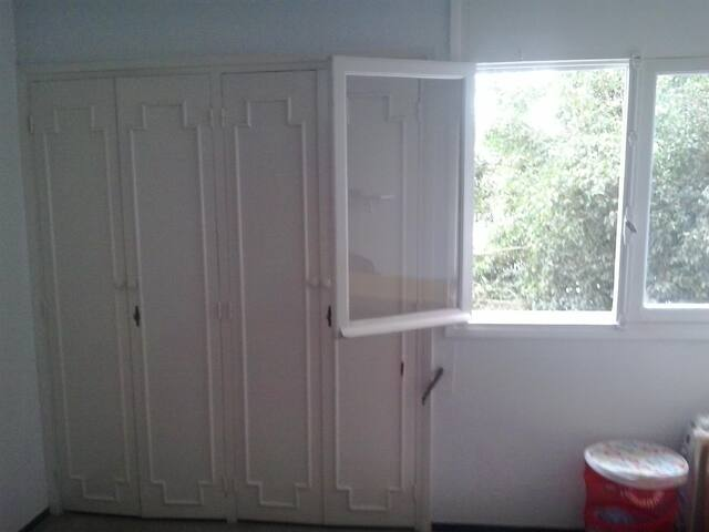 wardrobe, windows and sunlight in the private room