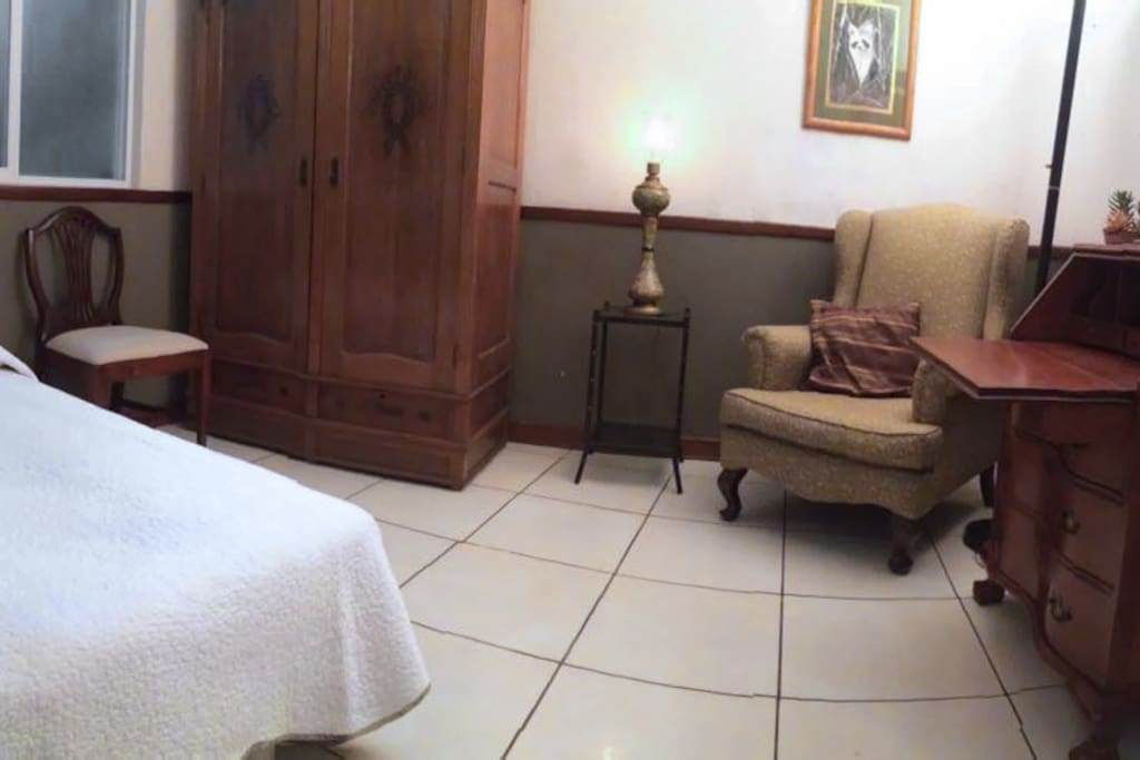 Panoramic view of our comfy room. Twin bed, antique dresser and desk.