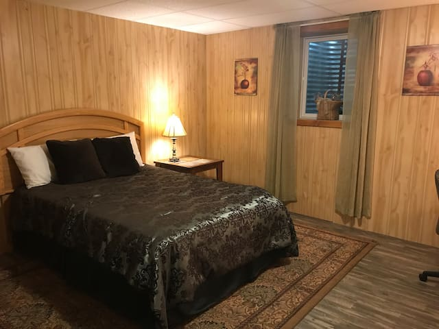 Large bedroom , queen bed and desk
