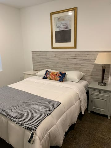 Room 107 is simple, clean, and welcoming. We love the grey and blue colors, which feel warm and inviting.