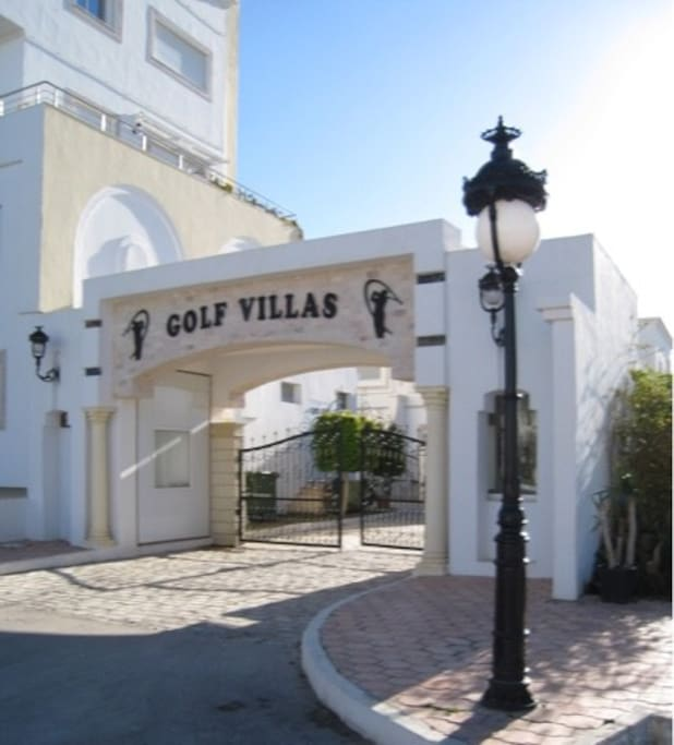 Gate of the villas near shops lounges