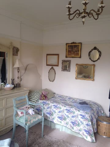 Large twin ground floor bedroom with sea views