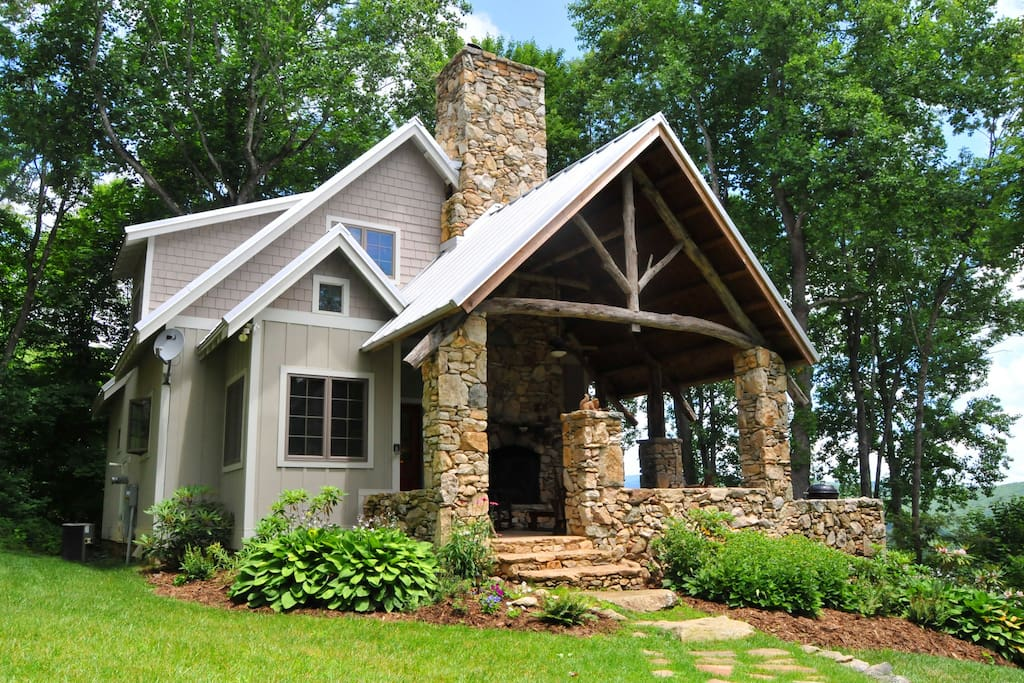 Stone and timber cottage with long range views from back patio
