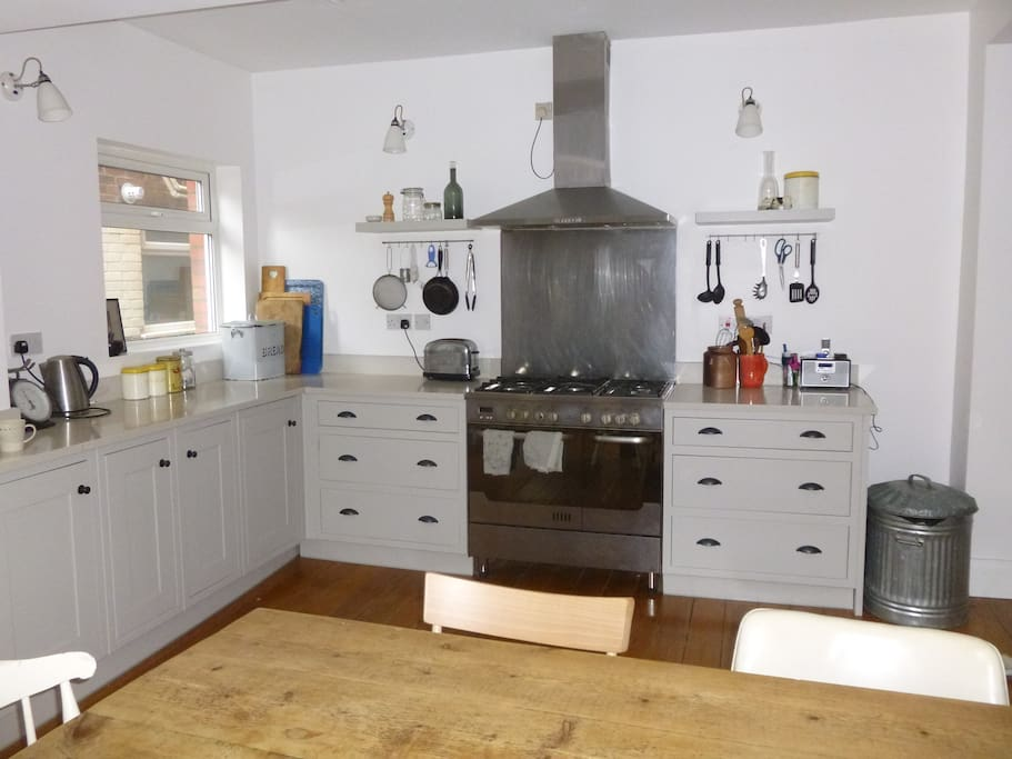 The kitchen has a range with five gas burners and two ovens, a dishwasher plus lots of worktop space