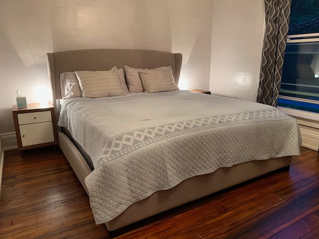 A relaxing king bed in a welcoming craftsman house