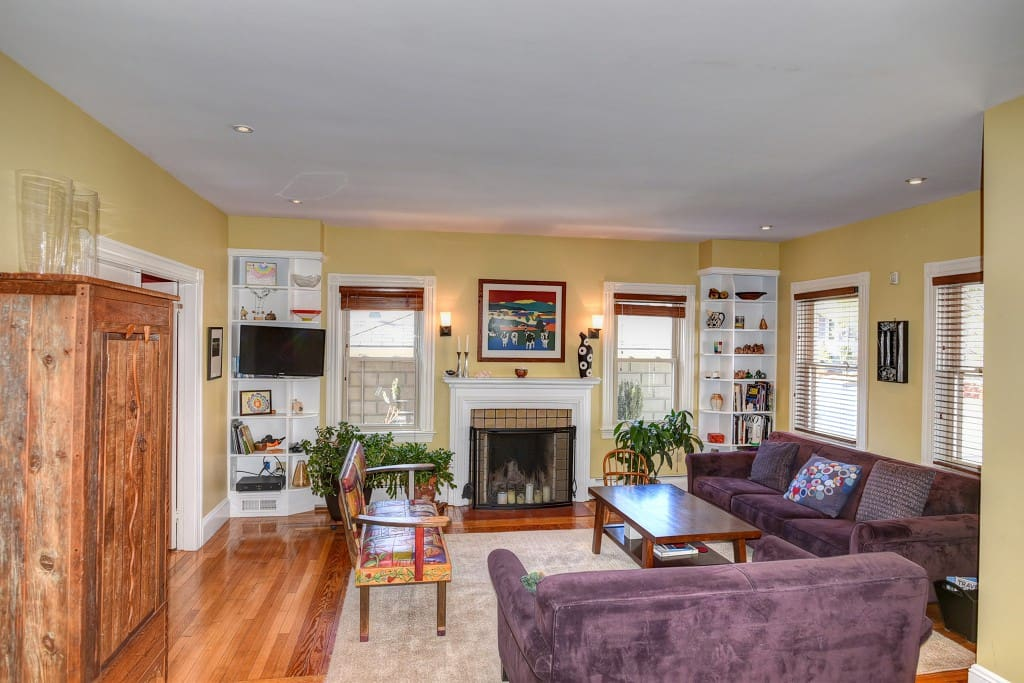 Living room with flat screen TV/FIOS and fireplace.