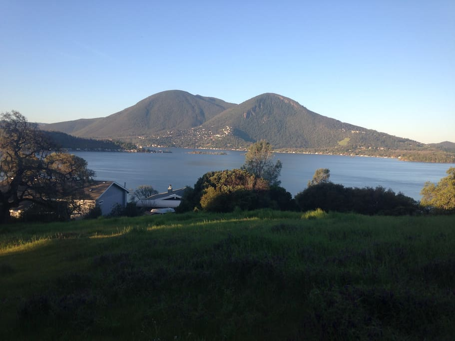 Breathtaking views of Clear Lake and Mt. Konocti from walking trail on 5 acre property!