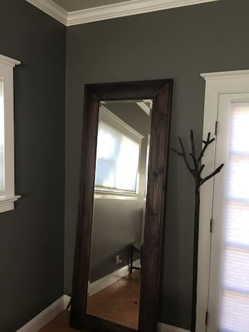 full length mirror and oak tree towel stand