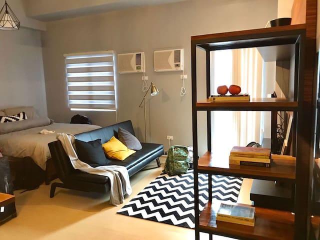 Industrially designed studio unit with balcony