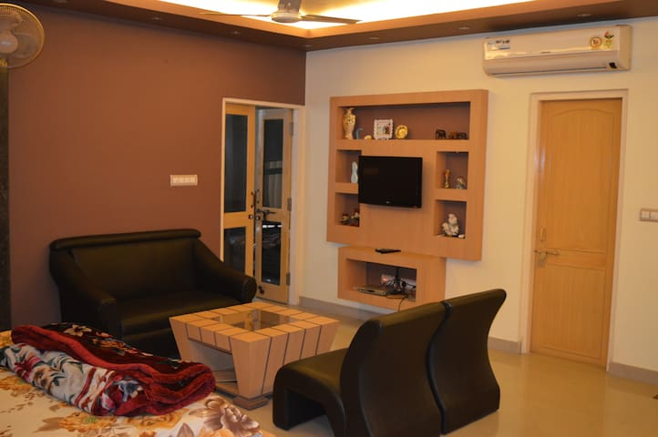 RedChillies 1 BHK Apartment bedroom+study room