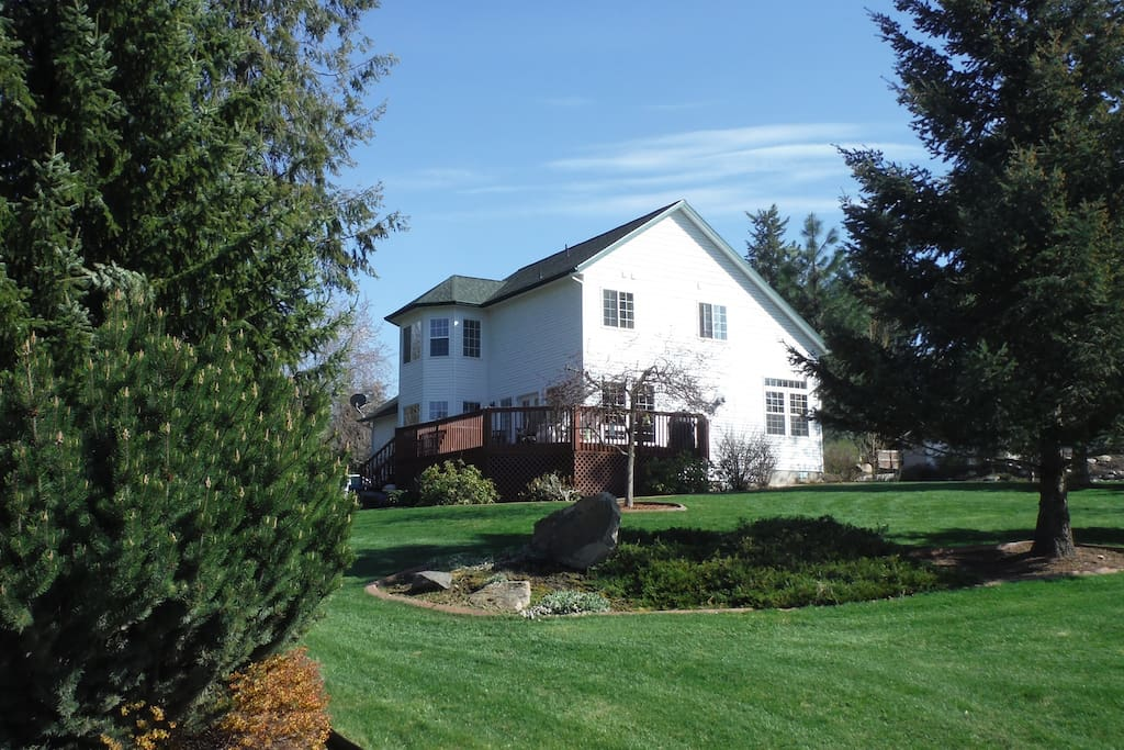Another view of our home. The deck is on this side of the home. You can sit out there and have a beautiful panoramic view of our surroundings. We have a partial view of Hauser Lake.