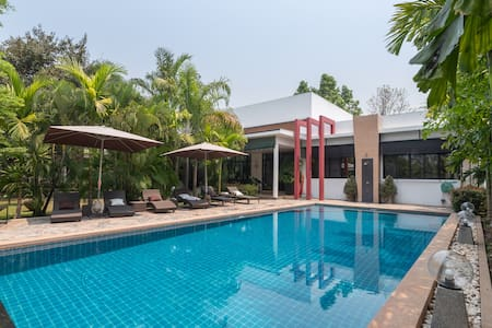 Luxury villa with infinity pool and maid service.