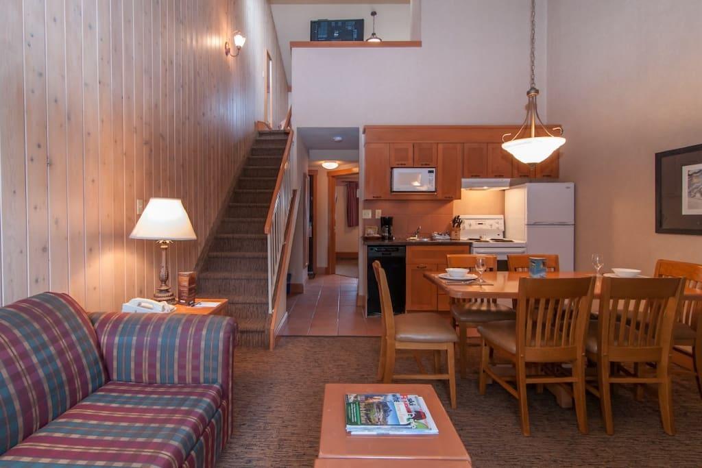 This gorgeous mountain condo features an open-plan living area.