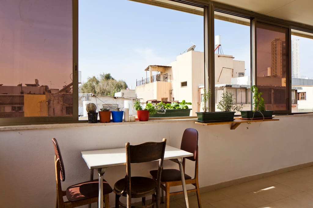 Soak up the sun on the balcony. We keep the windows open all year round - but in case of rain you can close them and still enjoy sitting outside.