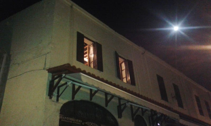 full moon and the front of the studio at night.