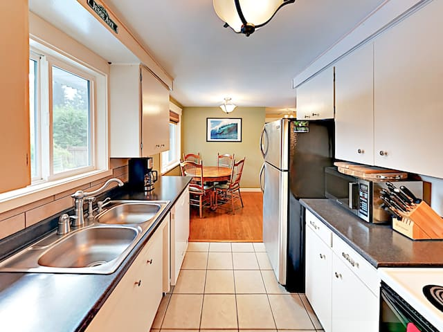 The kitchen is equipped with a full suite of appliances for all of your culinary needs.