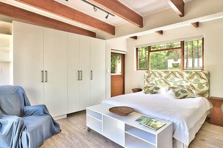 Large double bedroom leading to two courtyards and pool area.