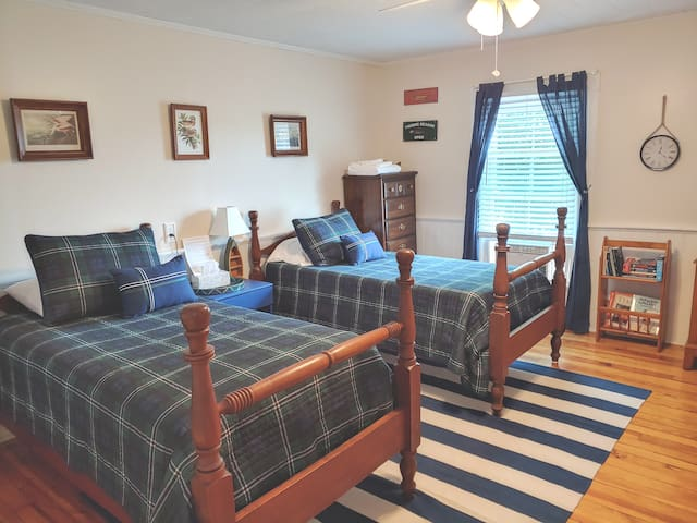 Two Twin Beds A/C Unit Heater Ceiling Fan 32 Inch Satellite TV Bookcase and Books Fishing/Nature Theme