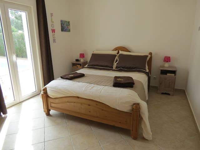 King sized beds for a great night's sleep in well furnished good sized rooms,  doors to patio and pool