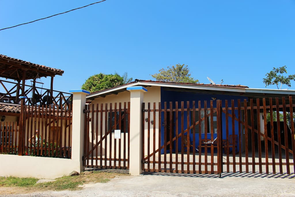 Gated front of home with driveway that allows ample parking