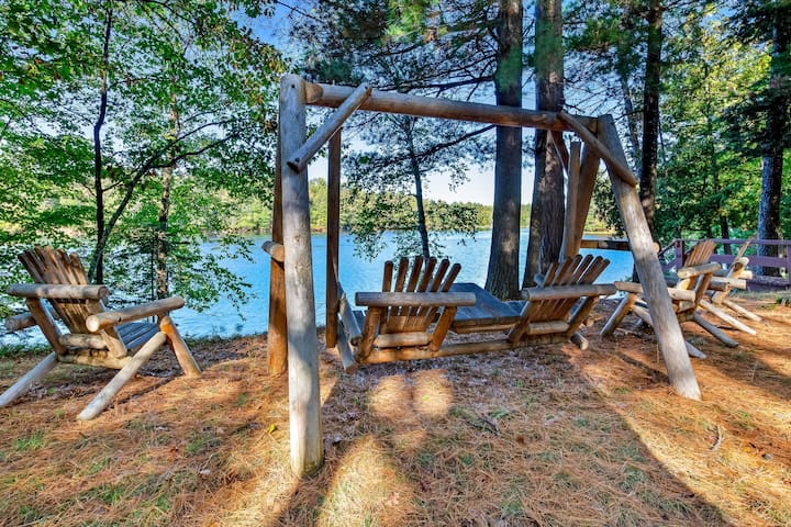 Charming lakefront home w/ fireplace, dock & canoe - close to town!