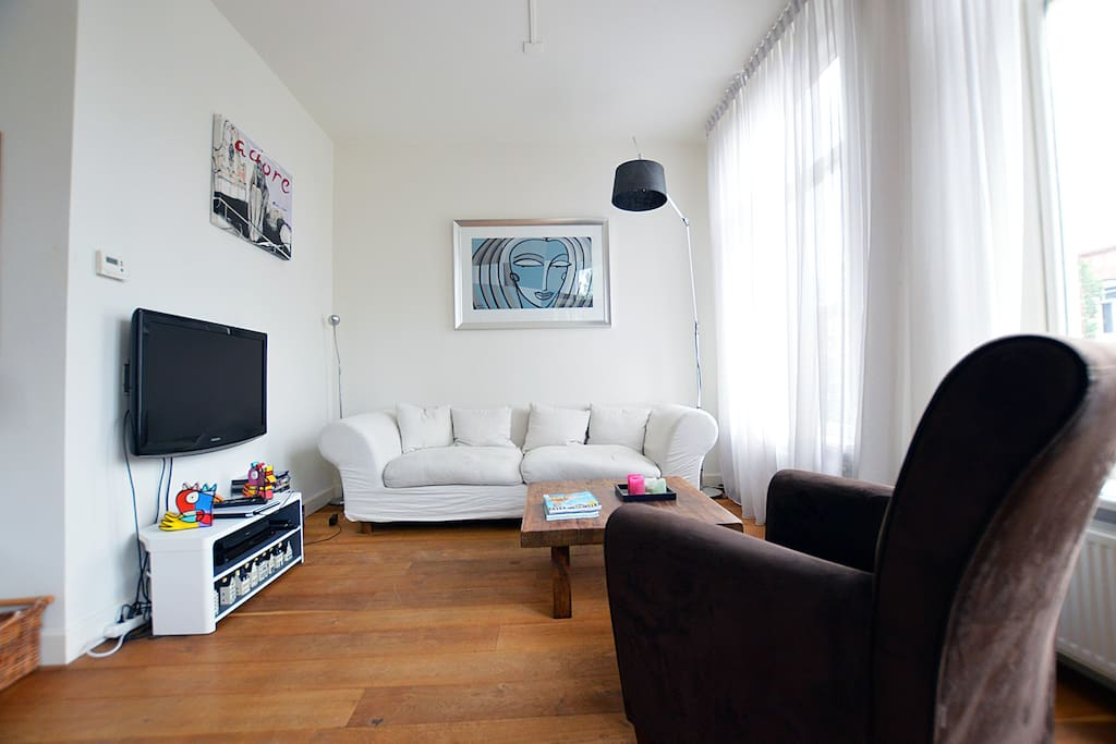 The living area has some great seats in which you can relax after a great day of exploring the city