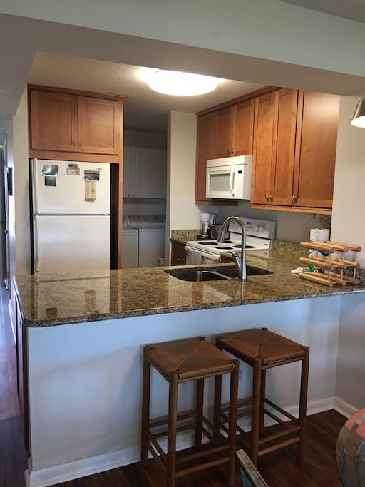 Nicely updated kitchen with granite and newer appliances