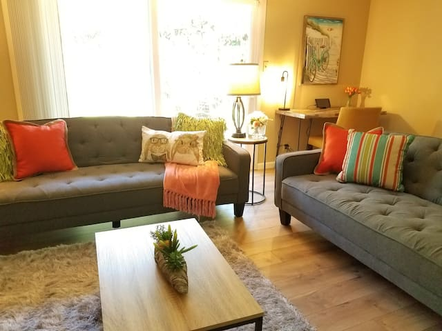 Get comfy in the cozy living room with plenty of seating for your group, a Smart HDTV & basic HiDef cable, a desk with chair for work (internet up to 150Mbps) , and easy entry to the backyard.