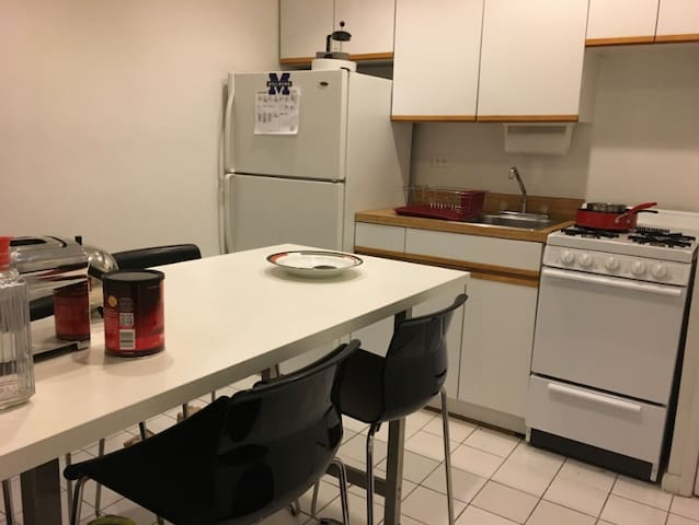 Kitchen fully equipped with refrigerator, sink, stove
