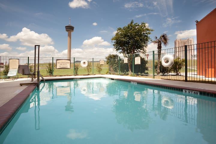 Free Breakfast + Outdoor Pool + 24-Hour Business Center | Only 3 Blocks from Gonzalez Convention Center