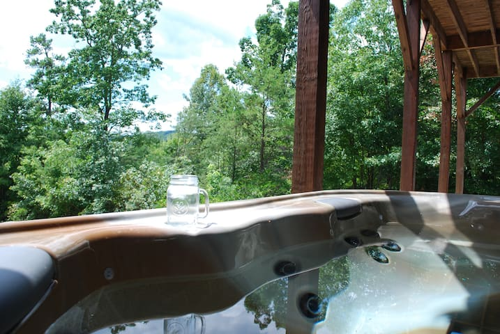 Enjoy the cool mountain air in the spacious hot tub that seats 5-6 guests.