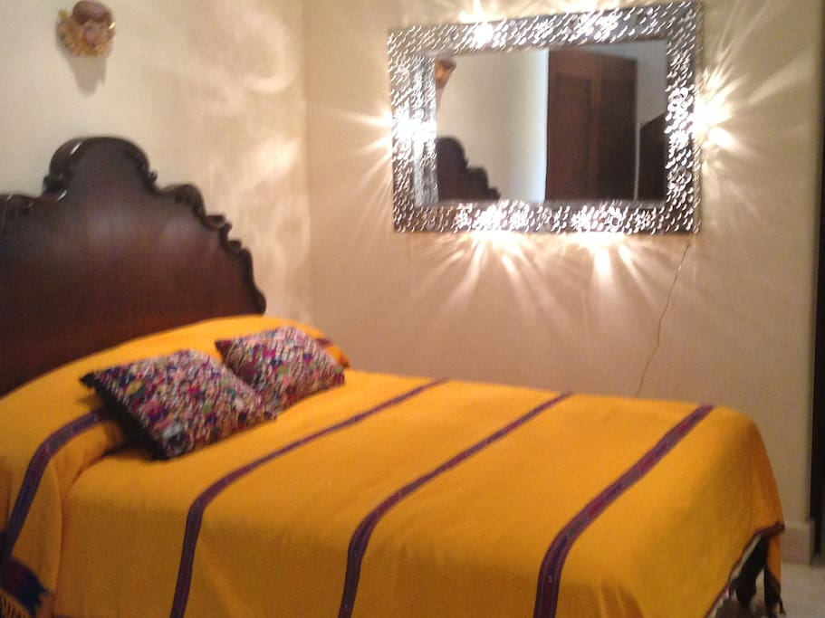 This bedroom includes a queen bed, sat tv and ensuite.