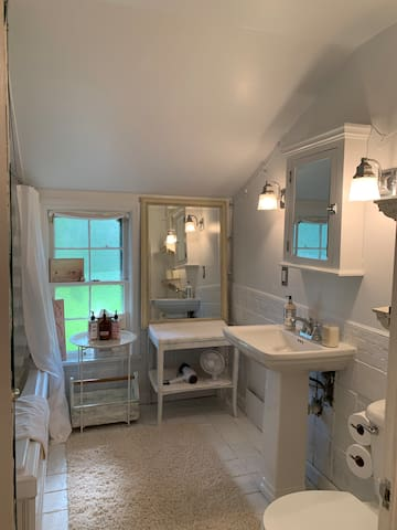 A bright white newly updated bath greets you filled with extra towels, toilet paper, hair dryer, and an abundance of shampoo, conditioner as well as anything you may have forgotten. We pay special attention to sanitizing your space. :)