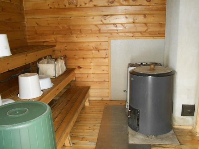 Sauna stove and firewood used water heater. You have to carry water from well to the sauna.(10m)