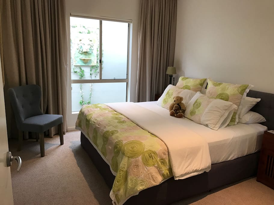 King size Bed with own private bathroom and powder room in separate wing of the house