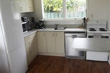 Well-equipped kitchen - clean and tidy with all the things you'd expect to find