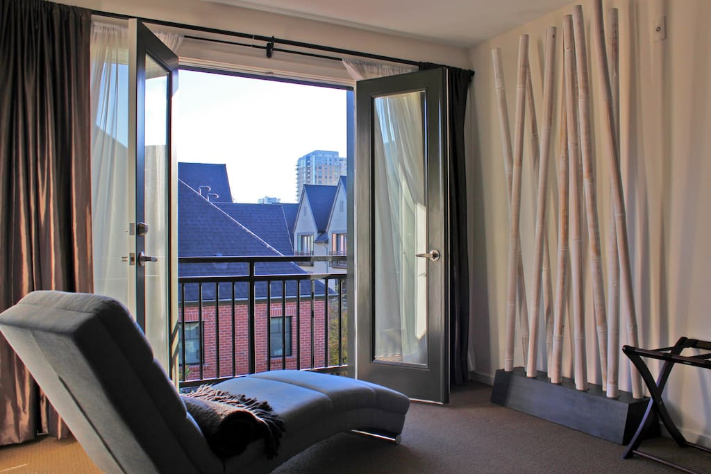 Catch up on your reading while lying on the chaise in the master suite overlooking the city through the Juliet balcony