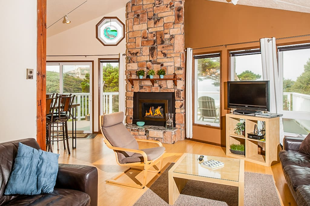 Relax in the comfortable living room, outfitted with a fireplace and a wall of windows.