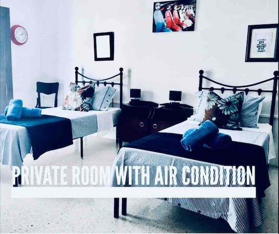 Private room with balcony and AC near bus station.